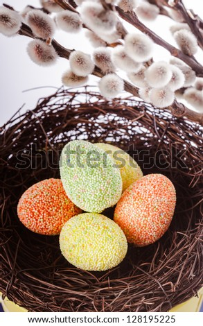 Pussy willow background and easter eggs decorations - stock photo