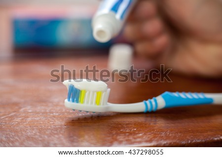 Put a toothbrush , toothpaste - stock photo