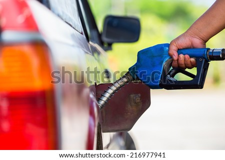 put in gasoline - stock photo