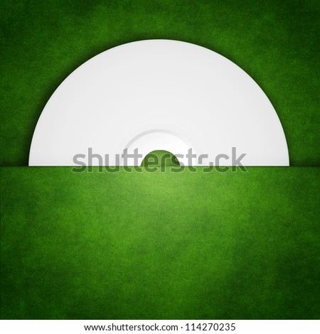 Put the CD in the package grass - stock photo