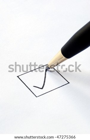 Put the check mark/tick in a box - stock photo