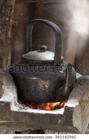 Put the kettle on the stove. Kettle which I am releasing water vapor is a smoke break between susceptible to wind. - stock photo