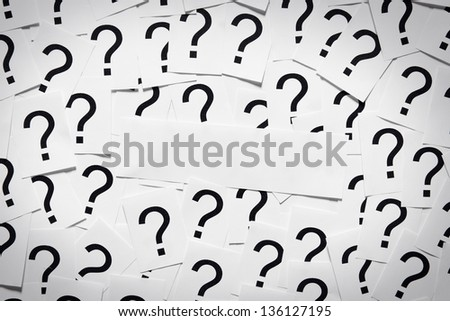 Put your own question on the label. Many question marks on paper. Question concept. - stock photo