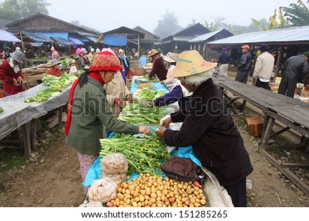 PUTAO, MYANMAR (BURMA)-JANUARY 4:Foggy morning at the local food market, northern town of Myanmar - remote and forbidden for tourism, restricted area. January 4, 2010 Putao, Myanmar (Burma). - stock photo