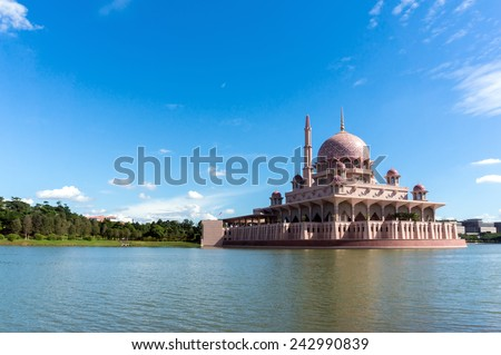 Putra Mosque in Putrajaya, Malaysia during a blue sunny day - stock photo