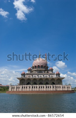 Putra Mosque (or masjid) at by the lake in Putrajaya, Malaysia. - stock photo