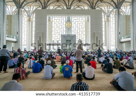 PUTRAJAYA - APRIL 30: Muslim performing Friday prayers at Tuanku Mizan Mosque on April 30, 2015 in Putrajaya Malaysia. Friday prayer is perform just after noon in the place of dhuhr