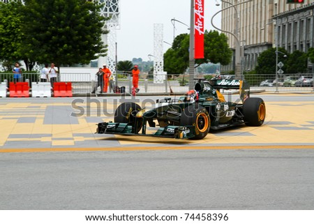 PUTRAJAYA, MALAYSIA - APRIL 2: Jarno Trulli of Team Lotus in action during F1 street demonstration on April 2, 2011 in Putrajaya, Malaysia. The event is a promotion for F1 Malaysia Grand Prix 2011.