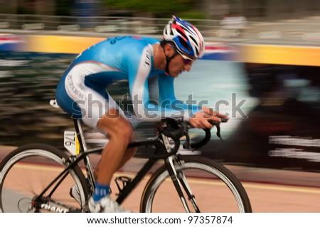 PUTRAJAYA, MALAYSIA - FEBRUARY 24: Maleki Mizan Ramin cyclist participates in Stage 1 of the Putrajaya Individual Time Trial for the 2012 Le Tour de Langkawi on Feb. 24, 2012 in Putrajaya, Malaysia - stock photo
