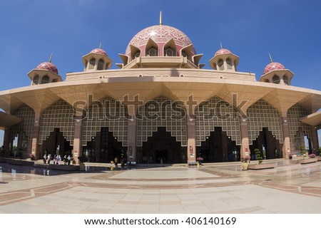 PUTRAJAYA, MALAYSIA, JAN 6, 2013 : Putra Mosque (Masjid Putra) is the principal mosque of Putrajaya, Malaysia. Putra mosque is one of popular destination among tourist. - stock photo