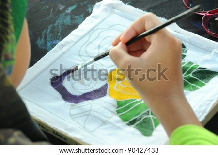 PUTRAJAYA, MALAYSIA - JULY 9: A student participates in a coloring contest at Malaysia's premier outdoor garden and flower showcase on July 9, 2010 in Putrajaya, Malaysia.