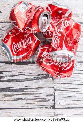 PUTRAJAYA, MALAYSIA - JULY 14TH, 2015. Crumpled Coca Cola cans. Coca Cola drinks are produced and manufactured by The Coca-Cola Company, an American multinational beverage corporation.