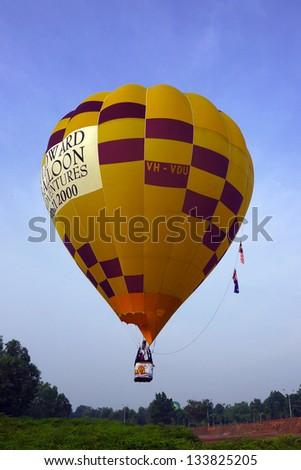 PUTRAJAYA, MALAYSIA - MAR 31 : A hot air balloon from Australia in flight at 5th Putrajaya International Hot Air Balloon Fiesta on Mar 31, 2013 in Putrajaya,Malaysia - stock photo