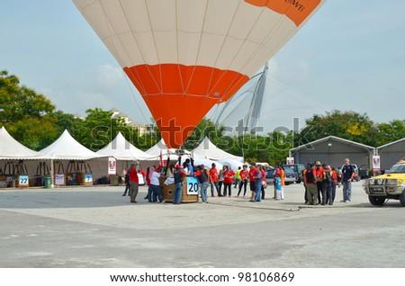 PUTRAJAYA, MALAYSIA-MAR 17:Balloon waiting visitor to fly at the 4th Putrajaya International Hot Air Balloon Fiesta on Mar 17, 2012 Putrajaya. The event held in Precinct 2, Putrajaya, Malaysia. - stock photo
