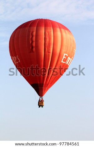 PUTRAJAYA, MALAYSIA-MAR 16: Frank Wecther (USA) with balloon in flight at the 4th Putrajaya International Hot Air Balloon Fiesta Mar 16, 2012 in Putrajaya. - stock photo