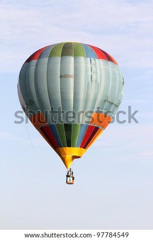 PUTRAJAYA, MALAYSIA-MAR 16: Imo Singh (India) with balloon in flight at the 4th Putrajaya International Hot Air Balloon Fiesta Mar 16, 2012 in Putrajaya. - stock photo