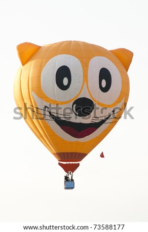 PUTRAJAYA, MALAYSIA-MAR 19:Unique Cat face balloon in flight at the 3rd Putrajaya International Hot Air Balloon Fiesta Mar 19, 2011 in Putrajaya.7 special shape balloons participate in this year event - stock photo