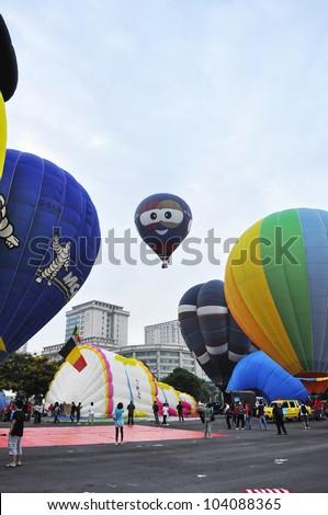 PUTRAJAYA, MALAYSIA-MAR 15:View of balloon at the 4th Putrajaya International Hot Air Balloon Fiesta on Mar 15, 2012 Putrajaya. The event held in Precinct 2, Putrajaya, Malaysia. - stock photo