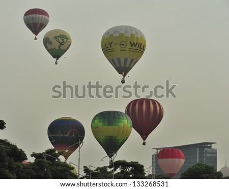 PUTRAJAYA, MALAYSIA - MARCH 29: Balloonists take part in morning flight during 5th Putrajaya International Hot Air Balloon Fiesta at Presint 2, Putrajaya on March 29, 2013. - stock photo