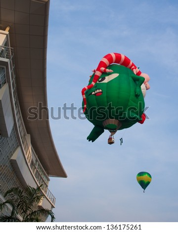 PUTRAJAYA, MALAYSIA - MARCH 30:Colourful and multi shaped hot air balloons flying at the 5th Putrajaya International Hot Air Balloon Fiesta in Putrajaya, Malaysia on March 30, 2013 - stock photo