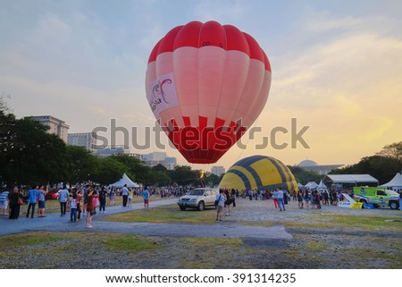 PUTRAJAYA, MALAYSIA - MARCH 13, 2016 - Colourful Hot air balloon floats in a site of flying ready to take off in 8th Putrajaya International Hot Air Balloon Fiesta in Malaysia on March 13, 2016. - stock photo