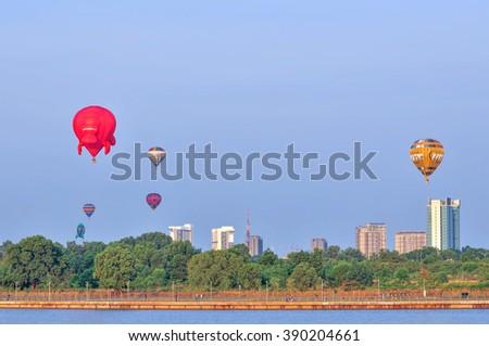 PUTRAJAYA, MALAYSIA - MARCH 13, 2016 - Hot air balloon floats over blue skies at the 8th Putrajaya International Hot Air Balloon Fiesta in Putrajaya, Malaysia on March 13, 2016 - stock photo