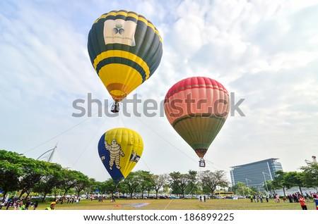 PUTRAJAYA, MALAYSIA- MARCH 29: Tethered hot air balloon rides for visitors at the 6th Putrajaya International Hot Air Balloon Fiesta March 29, 2014 in Putrajaya - stock photo