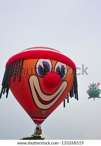 PUTRAJAYA, MALAYSIA - MARCH 29: Two hot air balloons fly over the horizon during 5th Putrajaya International Hot Air Balloon Fiesta at Presint 2, Putrajaya on March 29, 2013. - stock photo