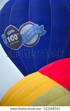 PUTRAJAYA, MALAYSIA - MARCH 29:Two hot air balloons seen in the vicinity of Putrajaya during 5th Putrajaya International Hot Air Balloon Fiesta at Presint 2, Putrajaya  on March 29, 2013 - stock photo