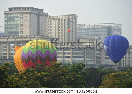 PUTRAJAYA, MALAYSIA - MARCH 29: Two tethered hot air balloons float on the air during 5th International Hot Air Balloon Fiesta at Presint 2, Putrajaya on March 29, 2013. - stock photo