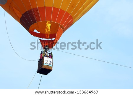 PUTRAJAYA, MALAYSIA - MARCH 29 : Unidentified visitors take the opportunity to fly with the balloon at 5th Putrajaya International Hot Air Balloon Fiesta on March 29, 2013 in Putrajaya, Malaysia. - stock photo