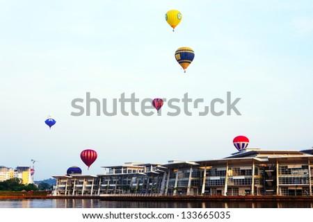 PUTRAJAYA, MALAYSIA-MARCH 29 :Variety of balloons take flight at the 5th Putrajaya International Hot Air Balloon Fiesta March 29, 2013 in Putrajaya.Over 250,000 people attended the event. - stock photo