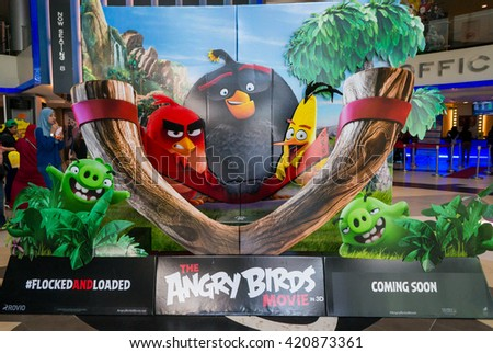 PUTRAJAYA, MALAYSIA - MAY 15, 2016: A wall sized Angry Bird poster displayed at IOI Putrajaya Mall. The Angry Birds Movie is a 3D computer-animated action adventure comedy film based on the video game - stock photo