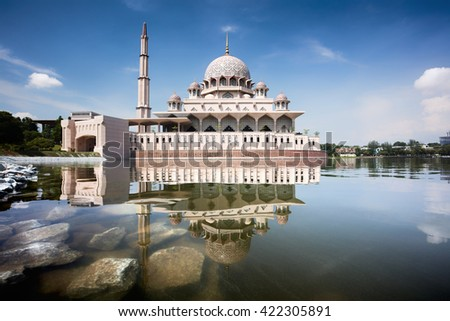 PUTRAJAYA, MALAYSIA - MAY 6 : The Putra Mosque or Masjid Putra, Putrajaya's famous pink mosque at May 6, 2016 in Putrajaya, Malaysia. - stock photo