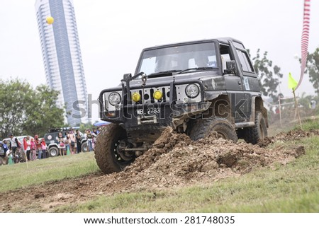 PUTRAJAYA, MALAYSIA - 24 MAY 2015. 4x4 in action at Festival Belia Putrajaya 2015. The event held annually to attract youngsters with outdoor activity. - stock photo
