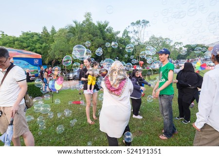 Putrajaya, Malaysia - 28 Nov 2016 : Kid and family playing water bubble at Putrajaya Lake Park is one of the most visited place in Putrajaya.