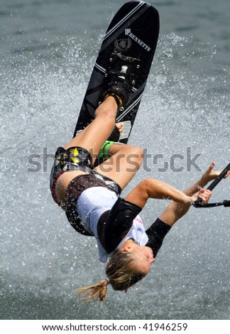 PUTRAJAYA, MALAYSIA - NOVEMBER 7: An unidentified participant shows her skills during 2009 Putrajaya International Waterski and Wakeboard competition on November 7, 2009 in Putrajaya, Malaysia - stock photo