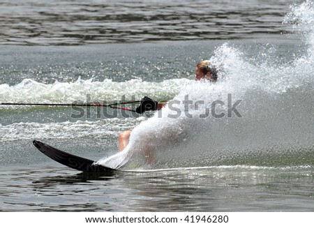 PUTRAJAYA, MALAYSIA - NOVEMBER 7: An unidentified participant shows her skills during 2009 Putrajaya International Waterski and Wakeboard competition on November 7, 2009 in Putrajaya, Malaysia