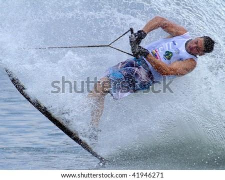 PUTRAJAYA, MALAYSIA - NOVEMBER 7: An unidentified participant shows his skills during 2009 Putrajaya International Waterski and Wakeboard competition on November 7, 2009 in Putrajaya, Malaysia - stock photo