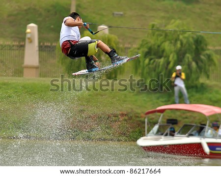 PUTRAJAYA, MALAYSIA - NOVEMBER 8: An unidentified participant shows his skills during 2011 IWWF Asian Waterski & Skateboard Championships in Putrajaya, Malaysia on October 8, 2011. - stock photo