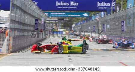Putrajaya, Malaysia - November 7, 2015 : Brazillian Lucas de Grassi of Team ABT Schaeffler Audi enters turn 1 at the FIA Formula-e ePrix Championship Putrajaya, Malaysia - stock photo