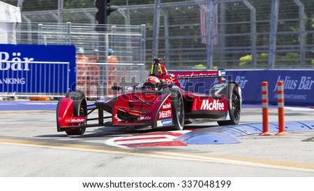 Putrajaya, Malaysia - November 7, 2015 : Loic Duval of team Dragon Racing enters turn 2 at FIA Formula-e ePrix Championship Putrajaya, Malaysia - stock photo