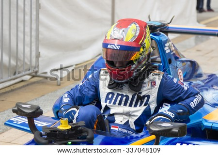 Putrajaya, Malaysia - November 7, 2015 : Netherlands Robin Frijns of Team Amlin Andretti exits his car after winning 3rd at FIA Formula-e ePrix Championship Putrajaya, Malaysia - stock photo