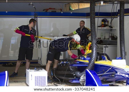 Putrajaya, Malaysia - November 7, 2015 : Team Renault DAMS mechanics prepare their car at FIA Formula-e ePrix Championship Putrajaya, Malaysia - stock photo