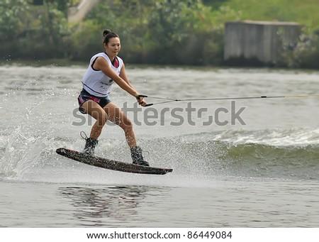 PUTRAJAYA, MALAYSIA - OCTOBER 8: An unidentified participant shows his skills during 2011 IWWF Asian Waterski & Skateboard Championships in Putrajaya, Malaysia on October 8, 2011. - stock photo