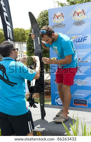 PUTRAJAYA, MALAYSIA - OCTOBER 9: Chiha Salvador from Lebanon wins the silver medal at 2011 IWWF Asian Waterski & Wakeboard Championships in Putrajaya, Malaysia on October 9, 2011. - stock photo