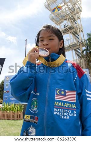 PUTRAJAYA, MALAYSIA-OCTOBER 9: Hanifah Aaliyah Yoong 8 years old from Malaysia wins the bronze medal at 2011 IWWF Asian Waterski & Wakeboard Championships in Putrajaya, Malaysia on October 9, 2011. - stock photo
