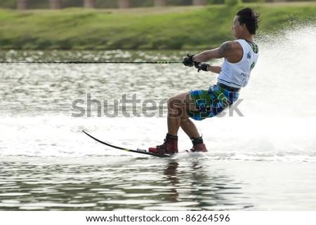 PUTRAJAYA, MALAYSIA - OCTOBER 9: Jeong Jimin from Korea showing his skills at 2011 IWWF Asian Waterski & Wakeboard Championships in Putrajaya, Malaysia on October 9, 2011. - stock photo