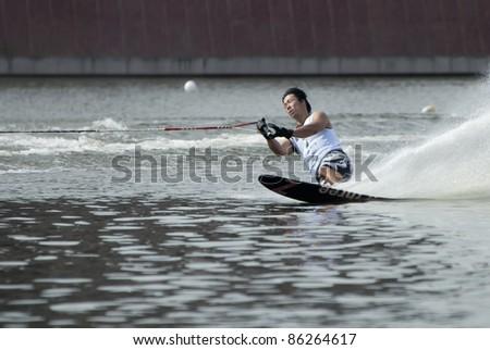 PUTRAJAYA, MALAYSIA - OCTOBER 9: Kim Dongeon from Korea showing his skills at 2011 IWWF Asian Waterski & Wakeboard Championships in Putrajaya, Malaysia on October 9, 2011. - stock photo