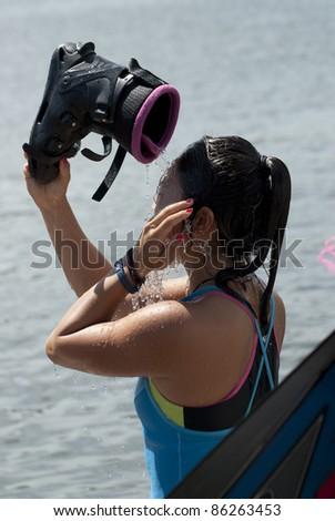 PUTRAJAYA, MALAYSIA - OCTOBER 9: Saaya Hirosawa from Japan after showing skills at 2011 IWWF Asian Waterski & Wakeboard Championships in Putrajaya, Malaysia on October 9, 2011. - stock photo